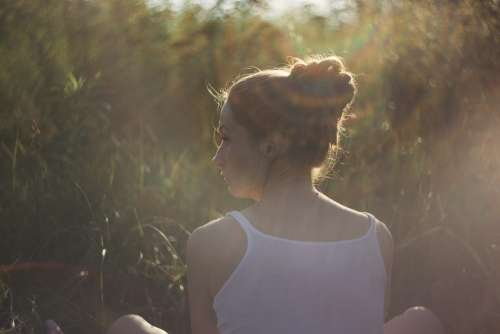 Girl in the rays of sun