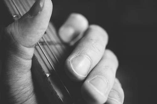 Guitarist hand playing guitar closeup 2