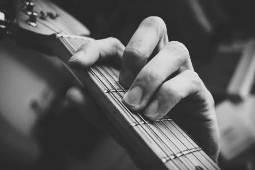 Guitarist hand playing guitar in black and white 2