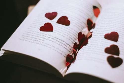 Heart confetti in an open book