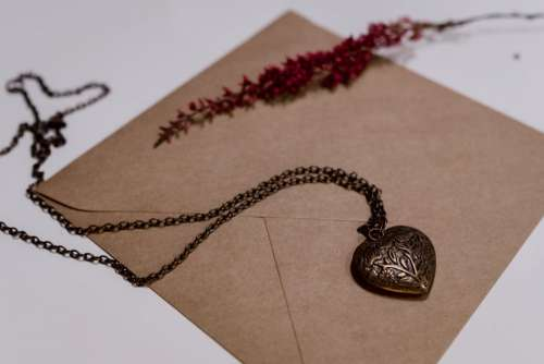 Heart necklace on a craft envelope