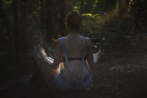 Helios shot of a girl meditating