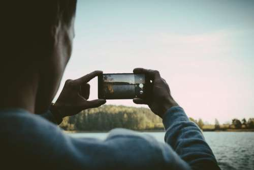 Man taking a picture with his cellphone