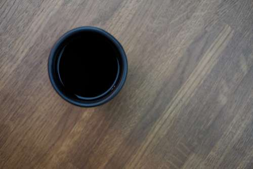 Mug of coffee on a wooden table 2