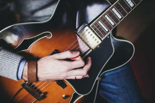 Playing guitar – front shot