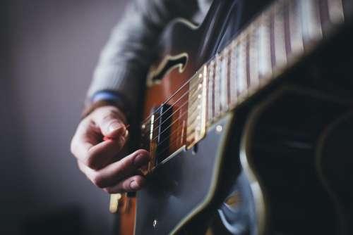 Playing guitar – side shot
