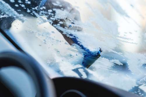 Removing frost from car windshield