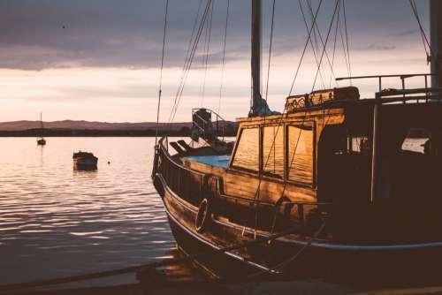 A sailing boat at sunset