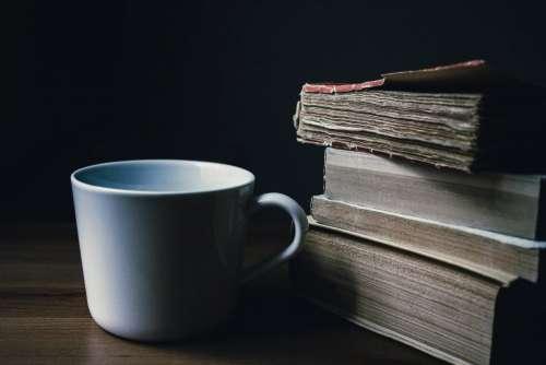 Tea mug and a pile of books