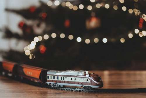 Toy train going around the Christmas tree
