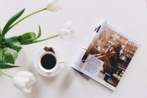 Tulips, cup of coffee and a magazine