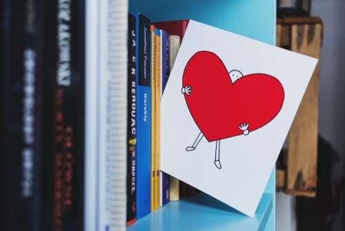 Valentines card on the bookshelf