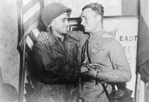 2nd Lt. William Robertson, US Army and Lt. Alexander Sylvashko, Red Army, Meeting of East and West free photo