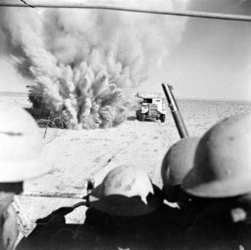 A mine explodes close to a British artillery tractor during 2nd battle of El Alamein free photo