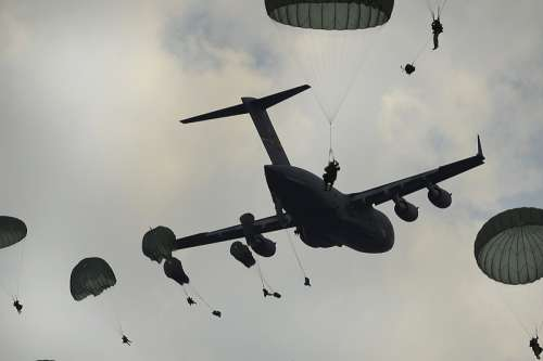 Airborne Paratroopers being dropped from a C-17 free photo
