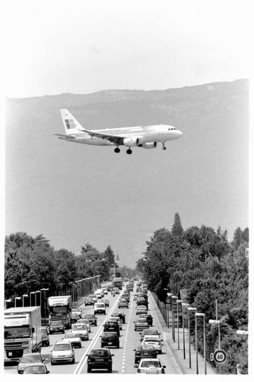 Airplane flying over Route de Meyrin, Switzerland free photo