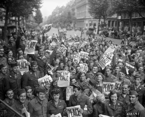 Allied military personnel in Paris celebrating V-J Day, End of World War II free photo