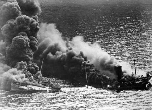 Allied Tanker Dixie Arrow after taking a Torpedo in World War II free photo