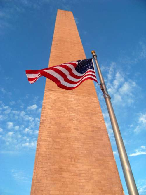 American Flag at the side of the Washington Monument free photo