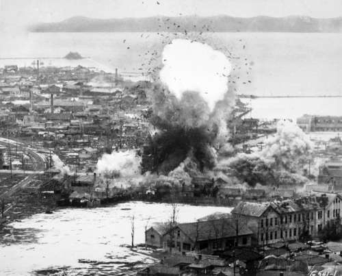 B-26 Invaders bomb logistics depots in Wonsan, North Korea, 1951, Korean War free photo