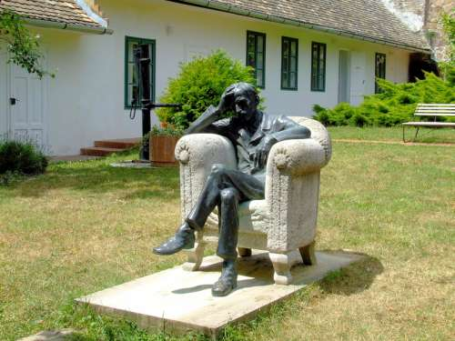 Babits Memorial House with man sitting in chair in Szekszárd, Hungary free photo