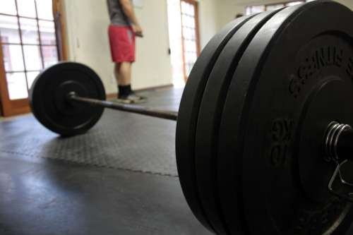 Barbell on Gym Floor free photo