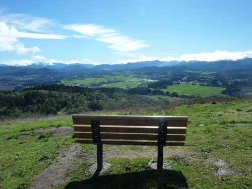 Bench overlooking the Valley landscape in Oregon free photo