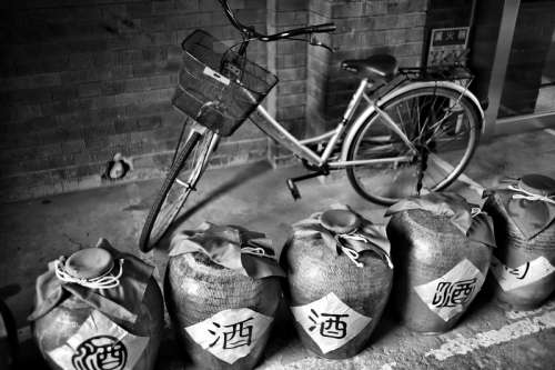 Bike with jugs of wine black and white free photo