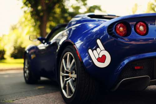 Blue Cars with cool hand symbol paint  free photo