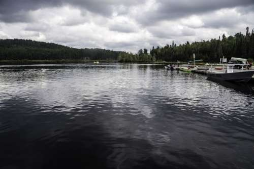 Boats and landscape on the lake in Algonquin Provincial Park, Ontario free photo