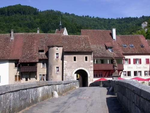 Bridge and buildings in  Saint-Ursanne, Switzerland free photo