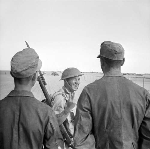 British soldier gives a V gesture to German prisoners during Second battle of El Alamein free photo