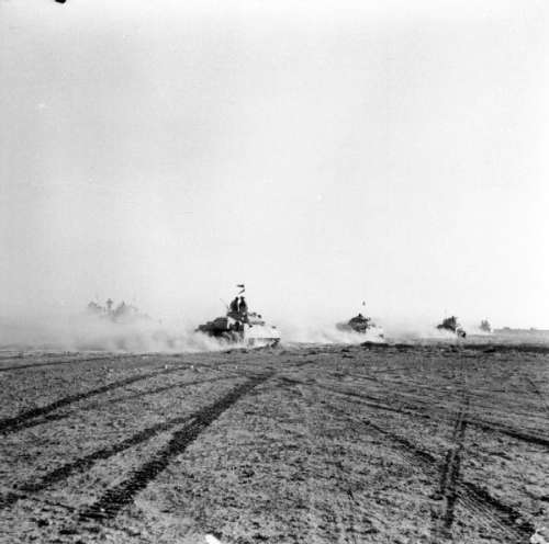British tanks advance to engage German armour  during Second Battle of El Alamein free photo