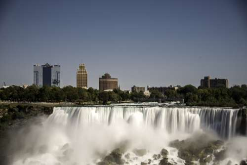Buildings above American Falls at Niagara Falls, Ontario, Canada free photo