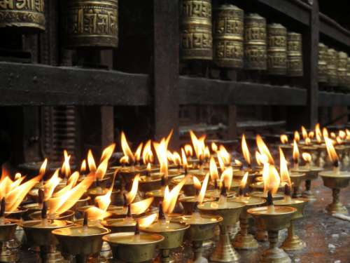 Candlelight offerings in the temple in Kathmandu, Nepal free photo