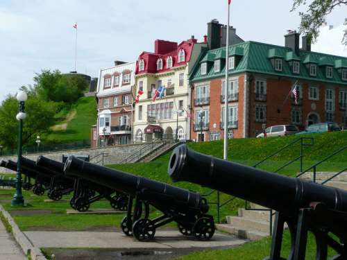 Cannons in front of the houses in Quebec City, Canada free photo