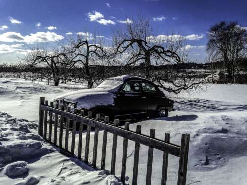 Car in the snow in New Hampshire free photo