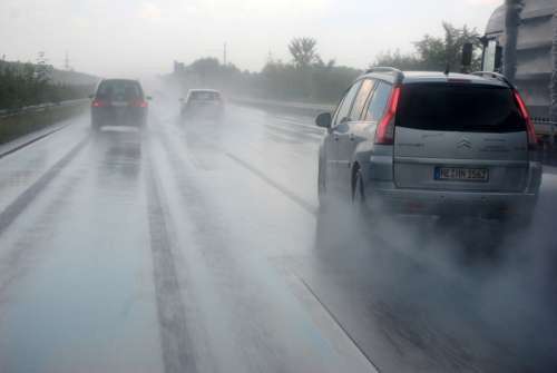 Cars Driving on a rainy day free photo