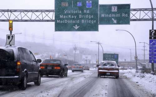 Cars heading toward the MacKay Bridge from Dartmouth in Nova Scotia in Halifax free photo