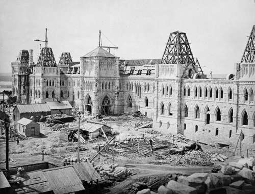 Centre Block on Parliament Hill under construction in 1863 in Ottawa, Ontario free photo