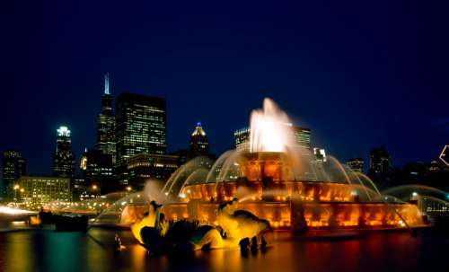 Chicago Fountain and skyline at night free photo