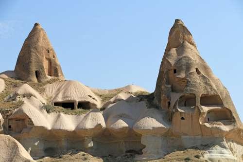 Chimney and houses in Cappadocia, Turkey free photo