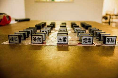 Chinese Army Chess setup on a table free photo
