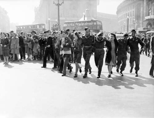 Civilians and service personnel in London celebrating V-J Day in England free photo