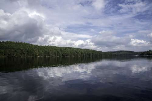 Clouds, lake, water, and trees at Algonquin Provincial Park, Ontario free photo