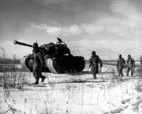 A column of the U.S. 1st Marine Division move through Chinese lines, Battle of Chosin Reservoir free photo