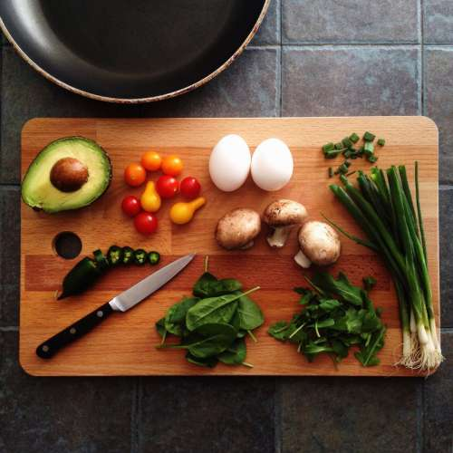 Cooking ingredients with avocado, mushrooms, and eggs free photo