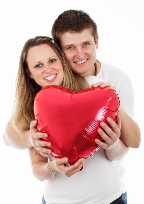 Couple holding heart balloon on Valentine's day free photo