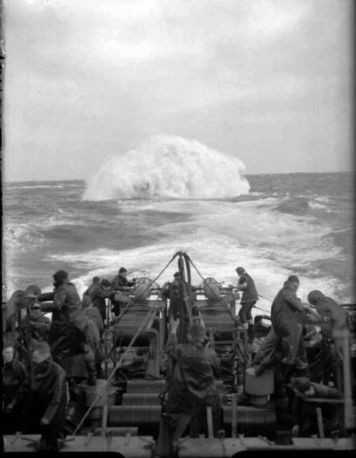 Depth charges detonate astern of the Sloop HMS Starling in World War II free photo