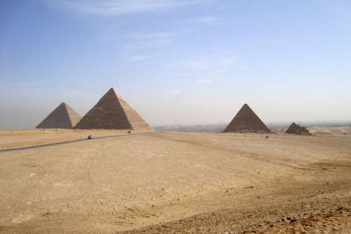 Desert landscape and Pyramids at Giza, Egypt free photo